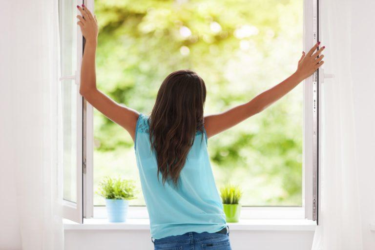 woman opening the window