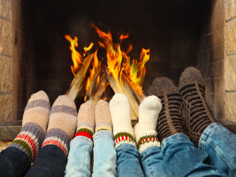 family at a fire place