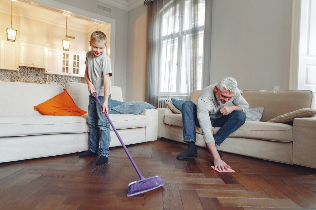 grandfather and child cleaning the floor