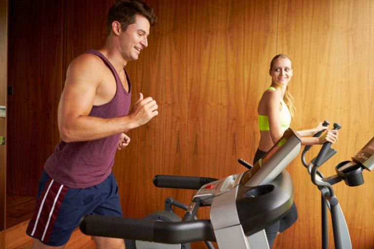 couple using a treadmill