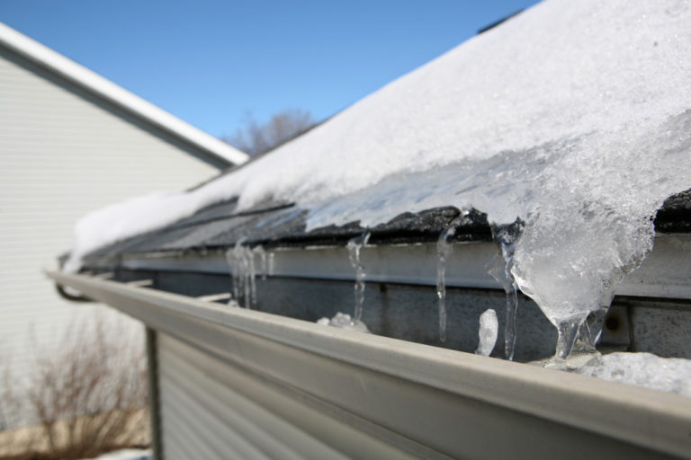 snow and ice on the roof