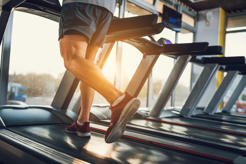 man running in treadmill